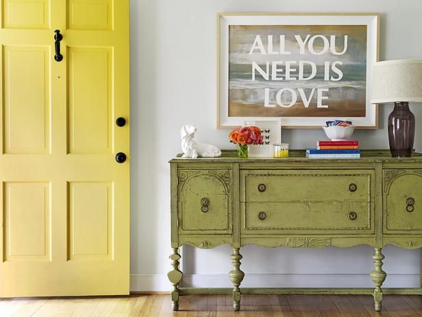 """Would you believe that cool art came from a yard sale? Yep! The homeowner stenciled """"All You Need Is Love"""" on it, and voila! #hgtvmagazine http://www.hgtv.com/decorating-basics/how-home-improvement-bloggers-live/pictures/page-3.html?soc=pinterest"""