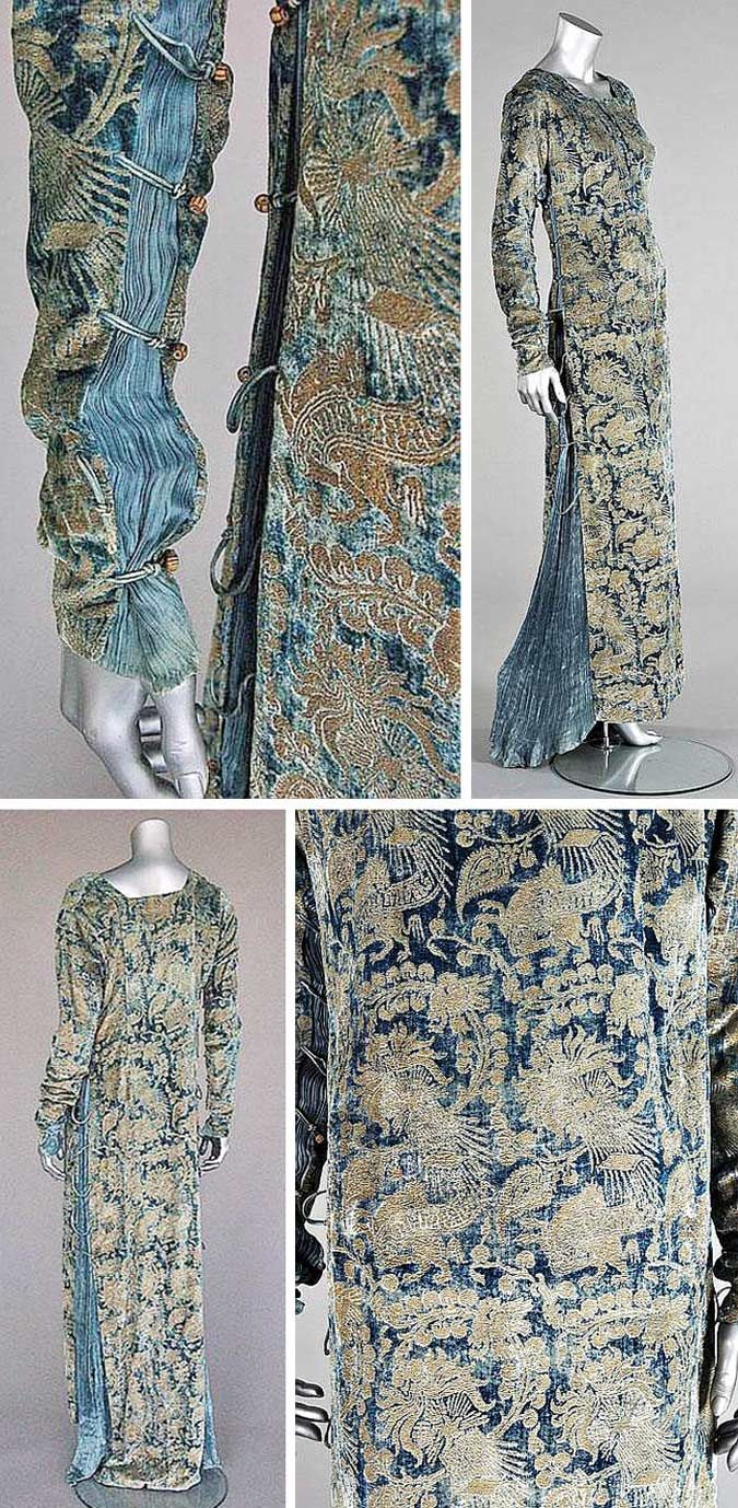Stencilled velvet gown, Mariano Fortuny, Venice, early 20th century. Blue velvet stencilled in gold with medieval-style patterns. Sides inset with pleated silk, laced with silk cords, & fastened with Murano glass beads. Kerry Taylor Auctions/Artfact