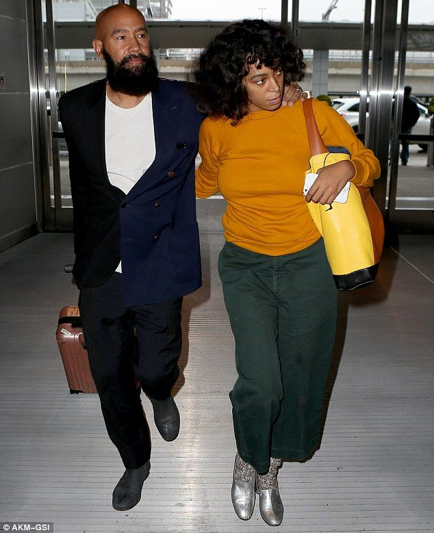 All loved-up: Solange Knowles and her husband Alan Ferguson are still clearly enjoying every moment of matrimonial bliss, as the couple looked more loved-up than ever on Tuesday