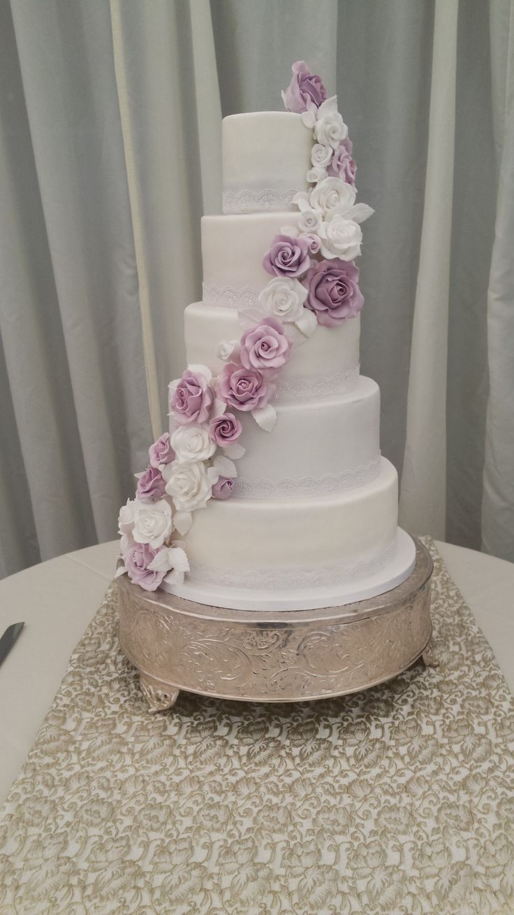 A gorgeous wedding cake with lilac and pink flowers to dress it and match in with the colour scheme!