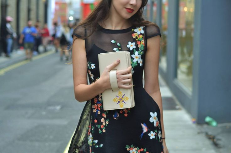 British vibes from an embroidered leather designer bag from Iutta. Clutch bag outfit with floral dress in London.  #londonfashionweek