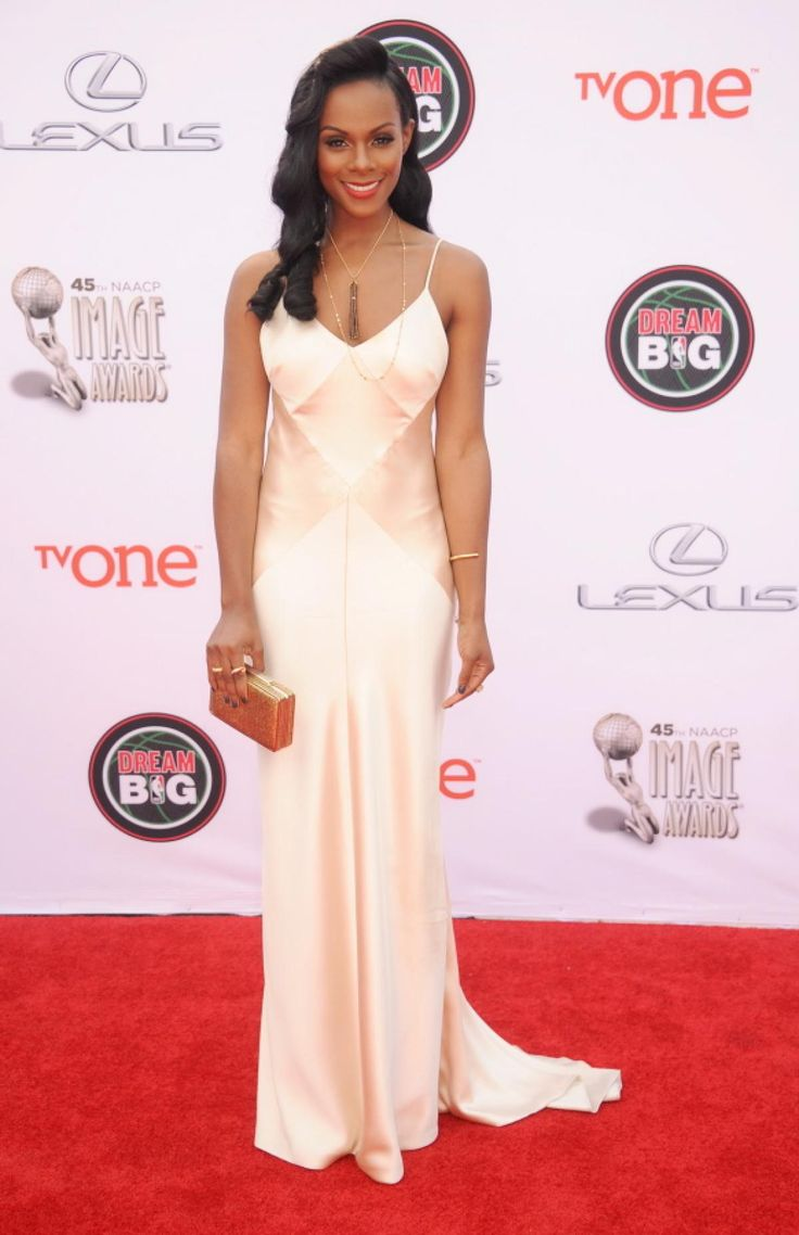 Actress Tika Sumpter oozed old Hollywood glamour when she hit the red carpet at the NAACP Image Awards on Feb, 22, 2014...Pretty, trying mixing fabric textures & add embellishments for that bridal look. Get that designer look without the designer $$$, have it custom-made.