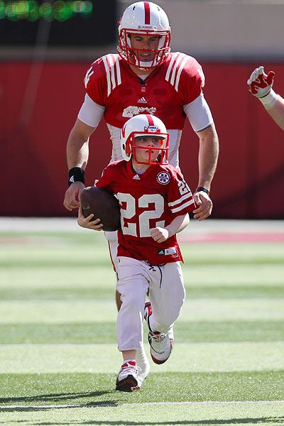 Love this shot of Jack's run, with Martinez following him <3 Jack Hoffman took the field with the Husker football team in the fourth quarter of Nebraska's spring football game and scored a 69 yard touchdown to win. Hoffman suffers from pediatric brain cancer.