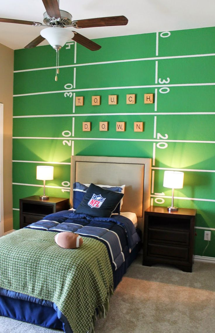 Football themed boys room. Back wall painted to look like a football field. Easy and quick how-to on theraggedwren.blogspot.com