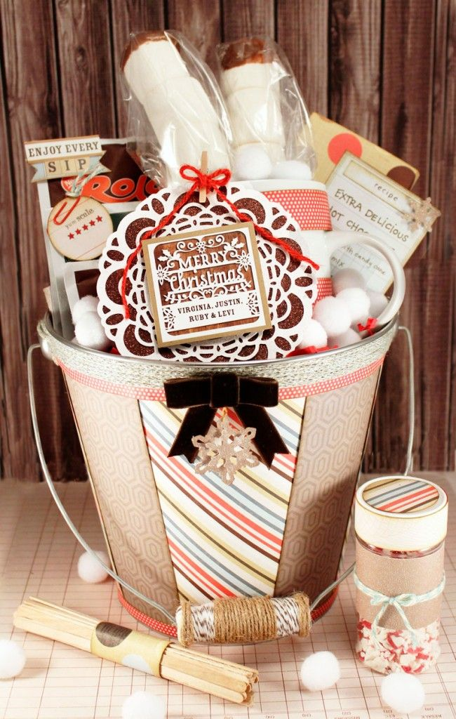 Hot Chocolate gift basket set. Include hot chocolate, mug, marshmallows, chocolate bar, recipe, stir sticks, candy cane rimier, neighbours will LOVE you!