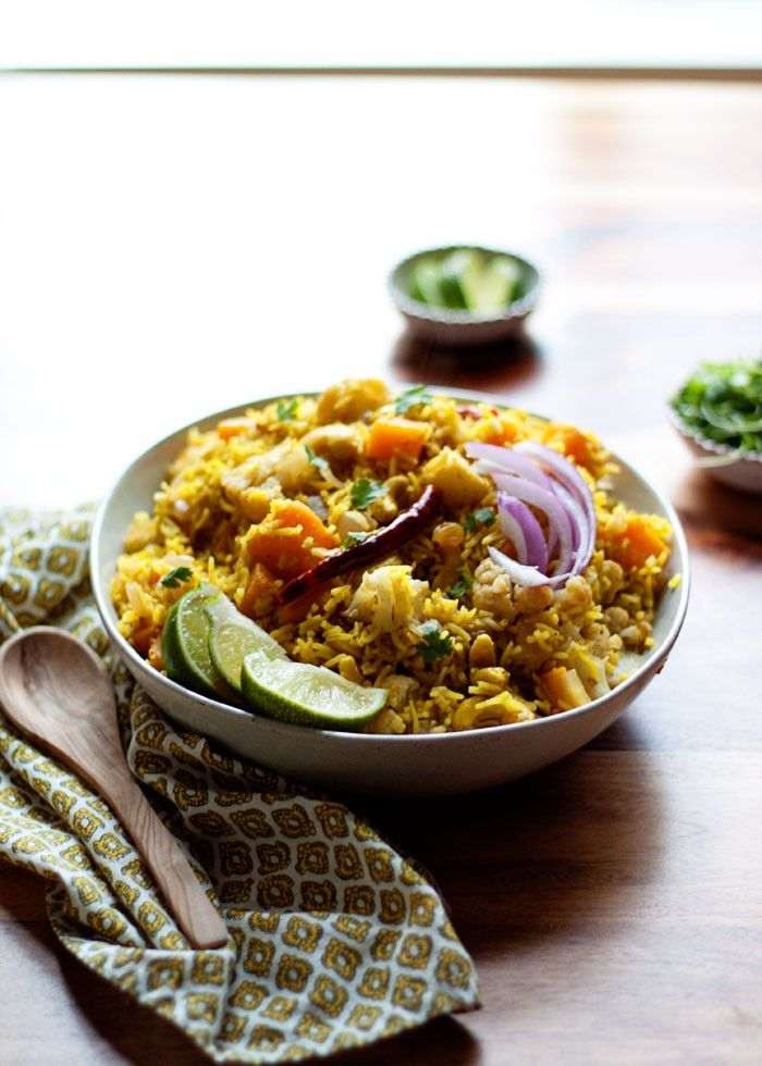 Biryani-Inspired Indian Vegetable Rice - This Indian-influenced, aromatic rice dish boasts butternut squash, cauliflower, cashews, golden raisins, and autumn-perfect flavors. And it's one of my favorite recipes for fall! Vegan.:
