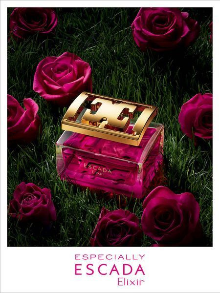 there is light shining directly onto the perfume bottle and there is pink roses round it which math the colour of the perfume that would make you think the perfume has a flower smell to it.