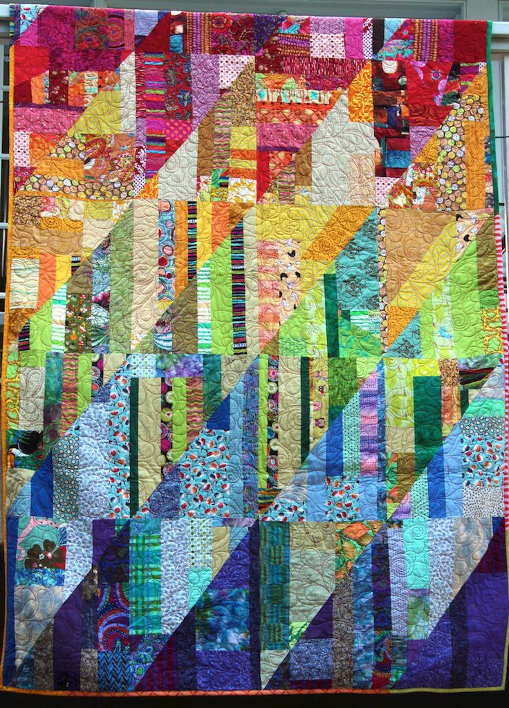 """This pretty quilt, from pieced goods.com, is made from scraps. The quilter describes her work, which had me thinking of a sort of improvisational variation on Margaret Miller's """"Strips that Sizzle"""" concept."""
