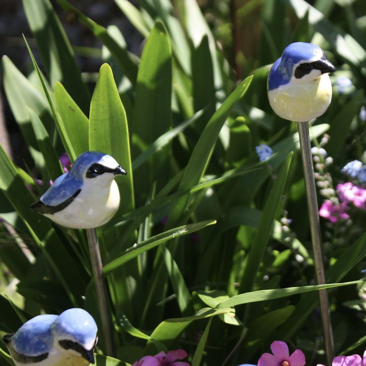 Miniature porcelain Wheatears on rods for the garden by Kathy Laird