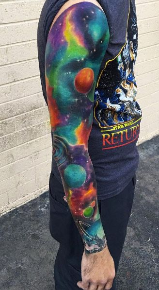 Colorful space sleeve tattoo by Kaitlin Dutoit