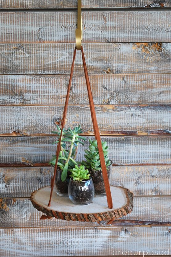 Tiny succulents will be a perfect complement to this hanging wood slice plant stand. The suede ribbon also adds a warm component to this piece.