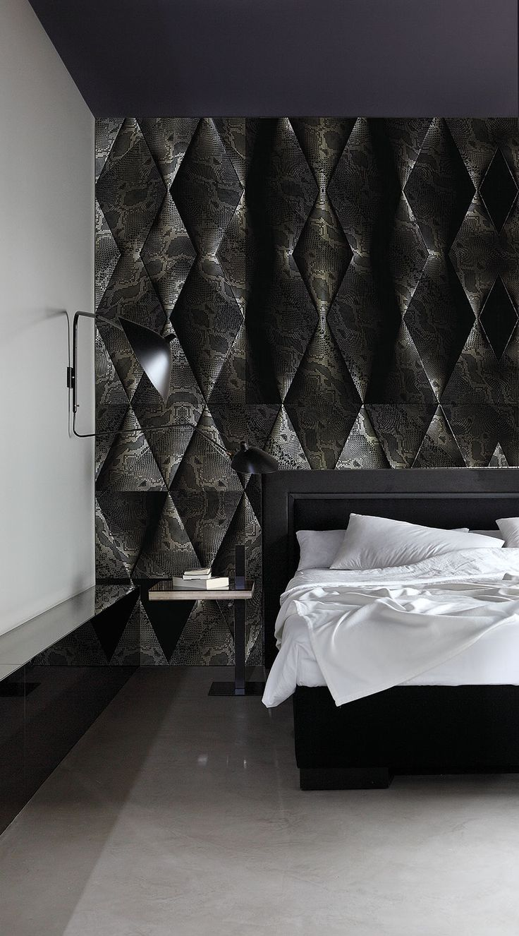 Python: treated natural fabrics and leather enriched with metallic affects that play on the light provide a sober and modern style, despite being combined with the wildest of graphic patterns