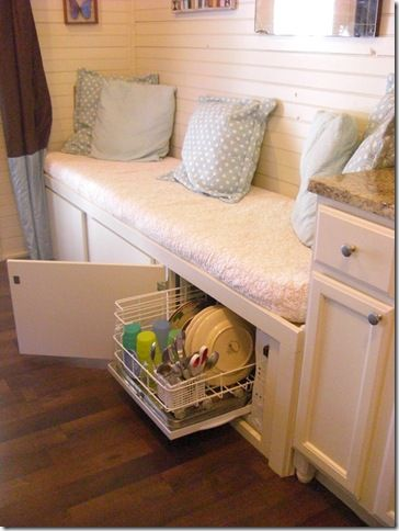 Surprise! I would never guess this was in there -- small dishwasher hiding in the cabinets that make up the sofa in Debra & Gary's 320 square foot cottage #organize