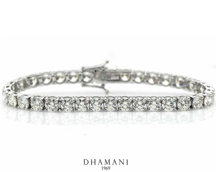 An Elegant 18k White Gold #Diamond #Bracelet weighing 17.67 grams, Studded with 14.27 carats of Natural Round #Diamonds - AT Dhamani The Dubai Mall #Dhamani1969 #luxury