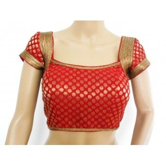A gorgeous red chanderi readymade designer blouse with antique gold shoulder bands and trims. Padded, princess cut, back hooks, dori with tassles.
