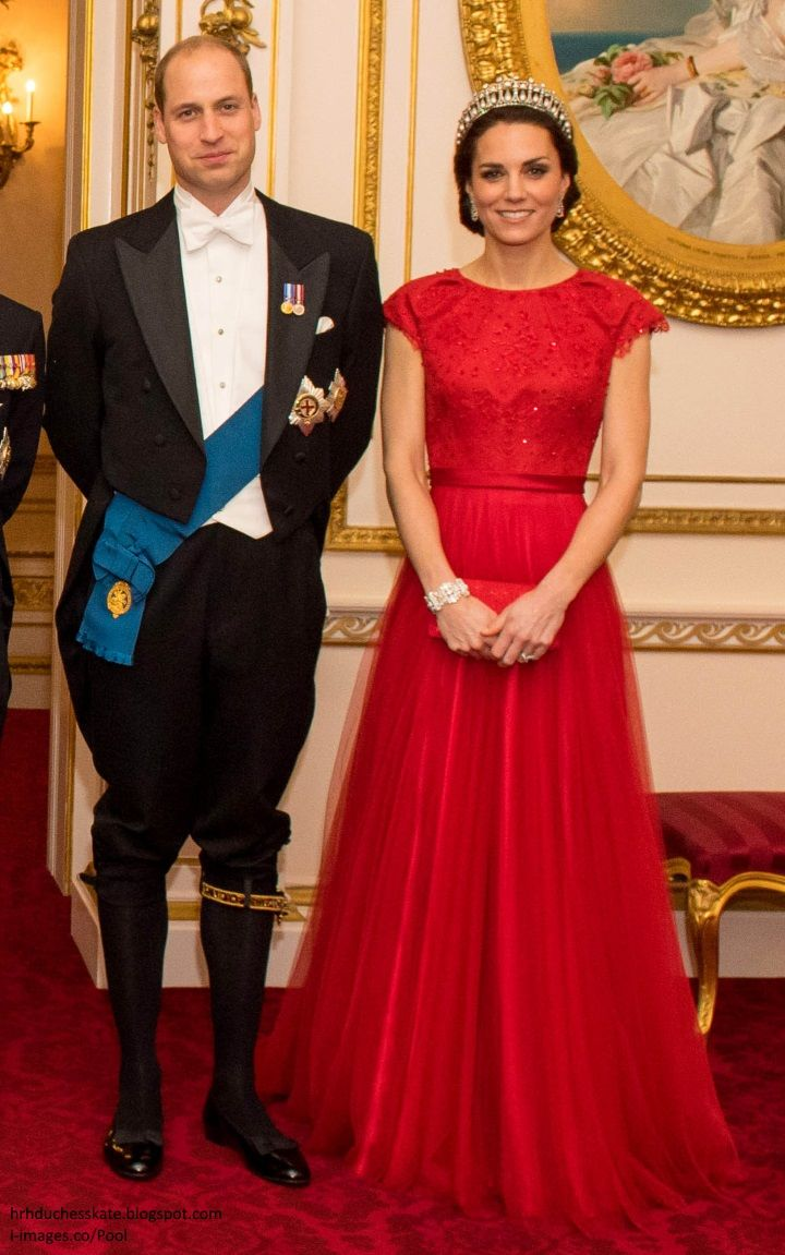 hrhduchesskate:  Diplomatic Reception, Buckingham Palace, December 8, 2016-Duke and Duchess of Cambridge; the Duke is wearing his Order of the Garter sash and riband; the Duchess is wearing her bespoke Jenny Packham red gown, first debuted in 2015, accessorized with the Lover's Knot Tiara, Diamond Earrings, and the Queen's Wedding Bracelet