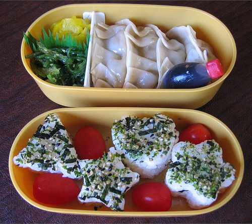 """Bento lunch with onigiri and steamed dumplings. Includes recipe for """"Best Dipping Sauce Ever""""."""