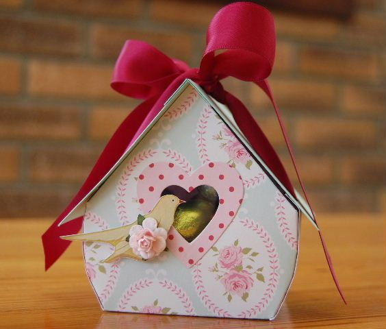 There is a template for this little birdhouse here: http://nicholeheady.typepad.com/files/bird-box-template.pdf