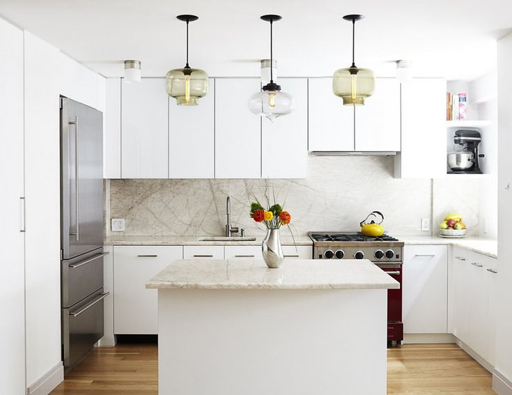 white kitchen pendant lighting. this modern white kitchen is punctuated by the unique pendant lights that lighting