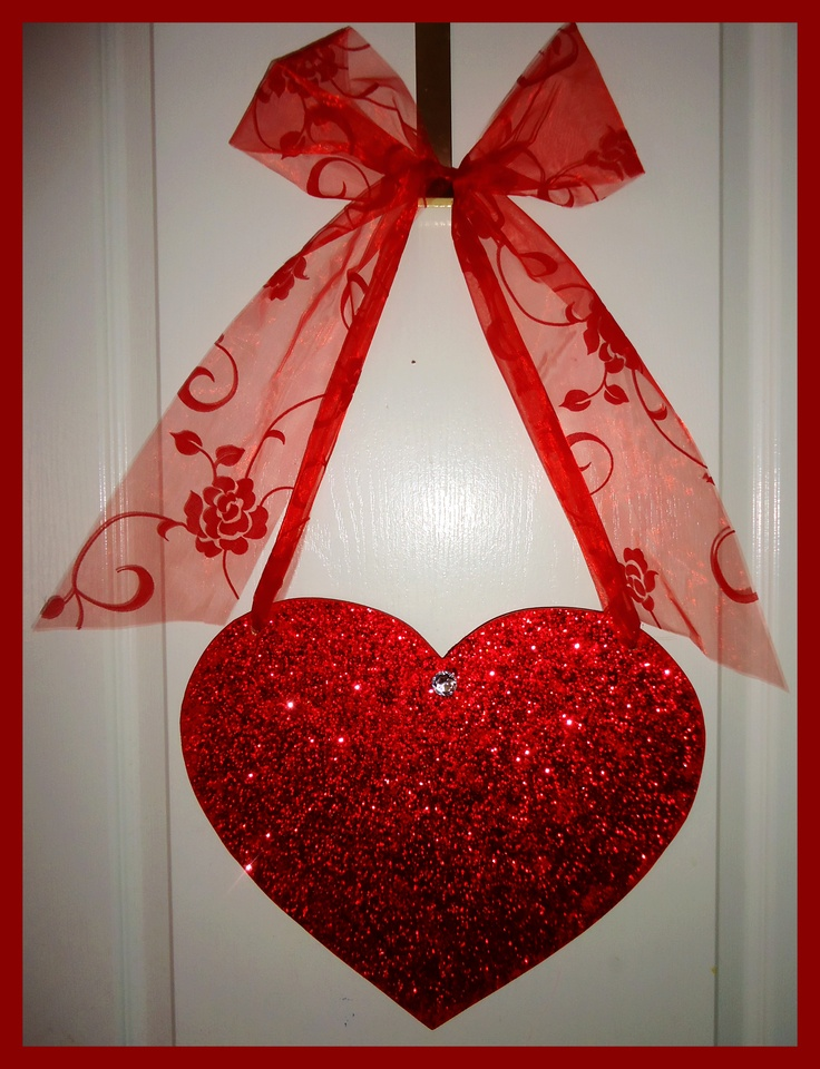 Glittering red heart wall décor.  Adds a loving atmosphere to any bedroom