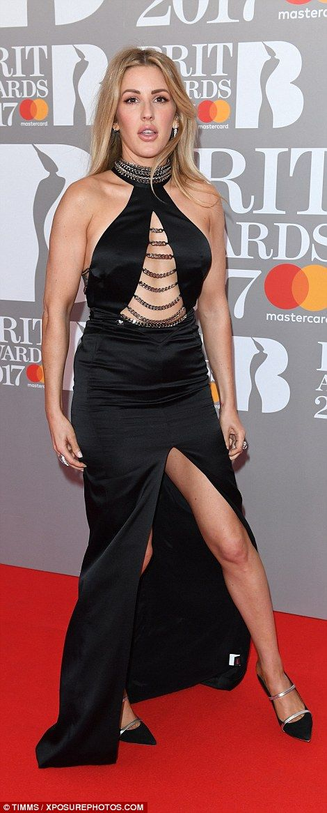 Legs for days: The edgy black dress boasted a daring thigh-high split running up the centr...