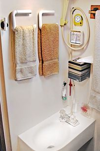 A flat toilet paper holder makes a space-saving towel rack. | 44 Cheap And Easy Ways To Organize Your RV/Camper