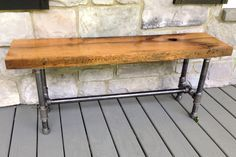 Reclaimed White Oak Bench with metal pipe legs. Reclaimed from old barn door sides the white oak is made for the outdoors. Comes with a clear oil based finish.