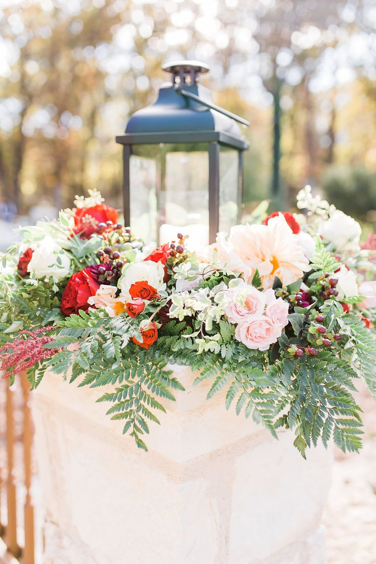 Beautiful lantern outdoor wedding decor!  Love how this lantern is used as decoration for this couple's outdoor ceremony.  The wild flowers around the lantern are to die for, and truly create the most beautiful, outdoor wedding atmosphere! Taken at THE SPRINGS in Rockwall, Poetry Hall.  Follow this pin to our website for more information, or to book your free tour! Photographer:  Hannah Way Photography #lantern #weddingdecor #weddingdecorations #outdoorwedding #outdoorweddingdecor