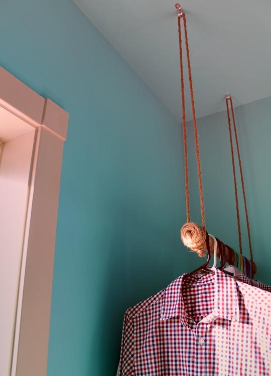 rope wrapped hanging clothes bar-would be fun for a cabin or laundry room...