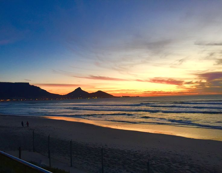 Stunning sunset over Milnerton Beach, Cape Town South Africa . With the gorgeous Table mountain in the back ground.