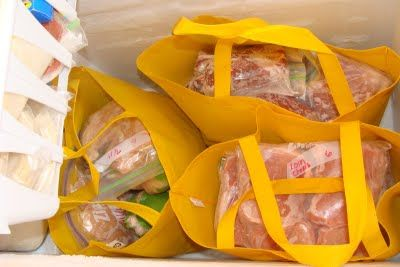use fabric shopping bags to organize deep chest freezer