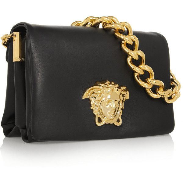 Black leather (Calf). Gold chain shoulder strap. Gold designer plaque and hardware. Two internal compartments, pouch pockets. Fully lined. Magnetic snap-fasten…