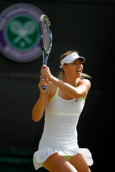 Maria Sharapova Photos - Maria Sharapova of Russia returns the ball during her Ladies' singles third round match against Su-Wei Hsieh of Taipei on day five of the Wimbledon Lawn Tennis Championships at the All England Lawn Tennis and Croquet Club on June 29, 2012 in London, England. - The Championships - Wimbledon 2012: Day Five
