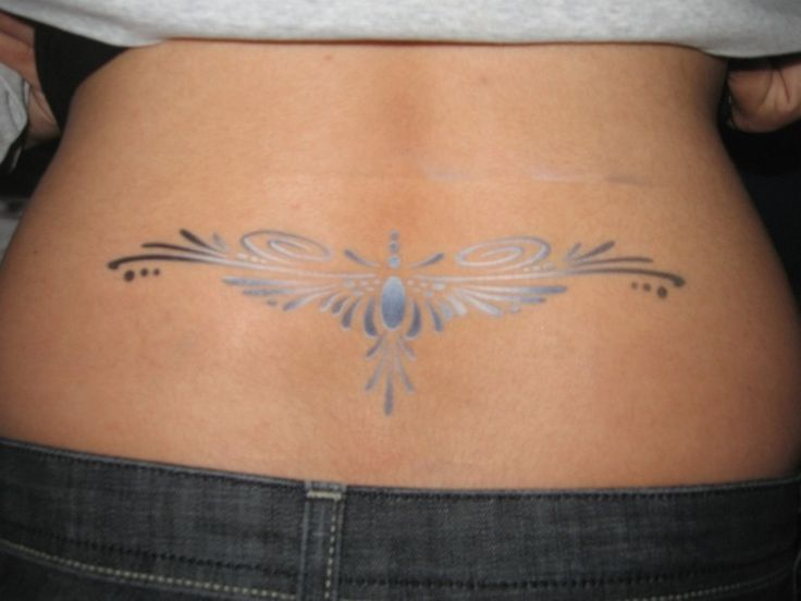 female tattoos on lower back   Picture of tribal silver tattoo on lower back