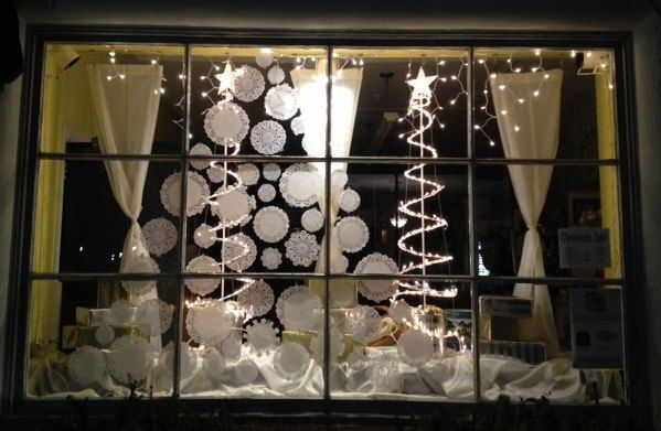Holiday window with lace doilies
