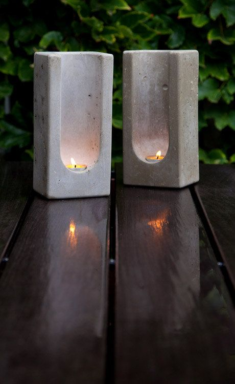 "Concrete tealight totems - made ""with a pleasing heft that is uncommon today."" It's true.~ could use a milk carton and a pop bottle for the hollow out part."