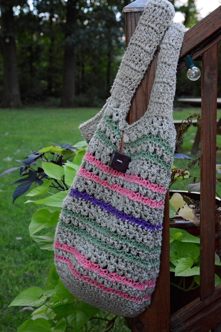 Large Boho tote that is crocheted with natural hemp twine and 100% cotton fibers. Lined with fabric. Large clay button.