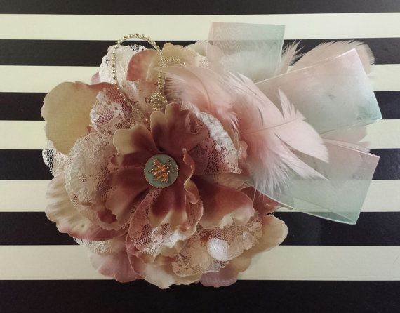 Pink and Mint green bridal fascinator. This piece has a whimsical romantic vibe. Perfect for a vintage or shabby chic inspired wedding. Measures 8