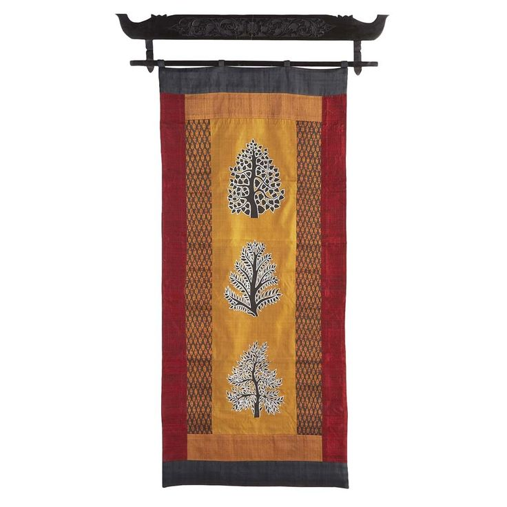 This stunning silk wall hanging featuring hand-woven Khmer ikat and traditional Angkor Wat tree motifs is an exclusive Ten Thousand Villages design, handcrafted by artisans of the Rajana Association of Cambodia. Following years of war, during which most educated people were killed, Cambodia is in the process of reviving traditional arts such as silk production and weaving. This almost-lost art is now providing valuable income for Cambodian artisans.
