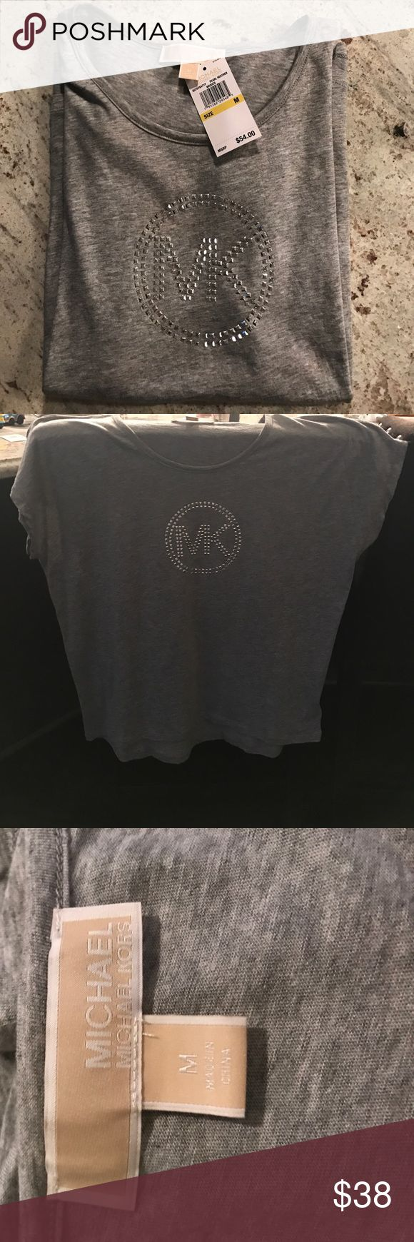 New Michael Kors Gray Tshirt!! Very cute brand new Michael Kors tshirt! Took tag off only to wear and it was too big - can't find receipt to return so selling! Super soft material and lightweight!! Medium. MICHAEL Michael Kors Tops Tees - Short Sleeve