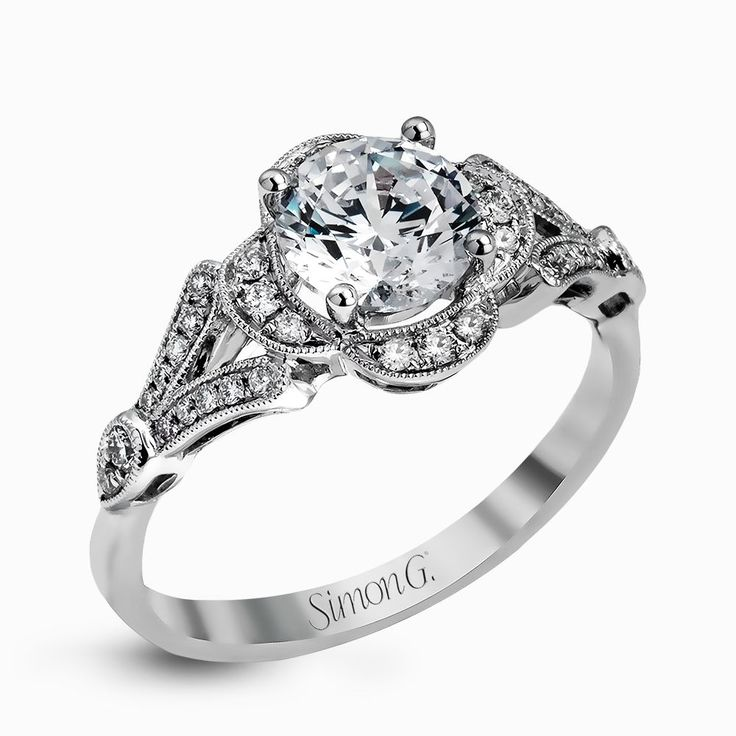 Accentuated With An Impressive Halo Design This Contemporary White Gold Ring Features Ctw Round Cut Diamonds