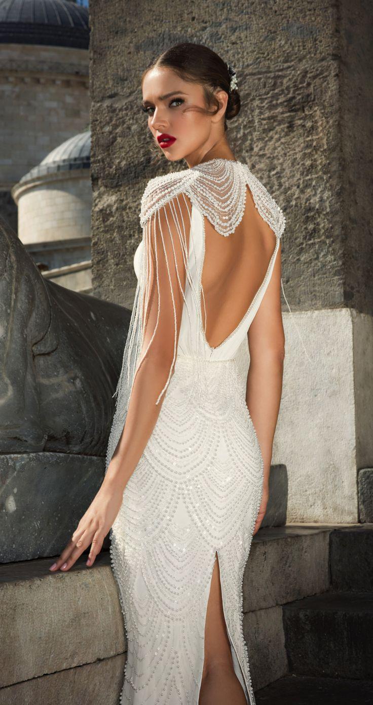 Style 1208, Julie Vino. Fitted wedding gown with beaded skirt, plunge neckline and shoulder detailing. #weddingdress #vintage #beading