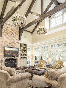 Seriously in love with this living room- the exposed beam ceiling, the rustic chandeliers, the brick fireplace, everything!  (6056 Deloache Avenue, Preston Hollow - Dallas, Texas)                                                                                                                                                                                 More