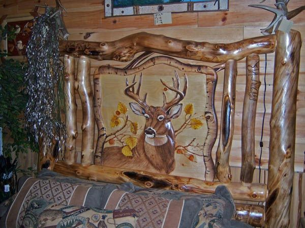 Detail of deer carving on aspen log bed headboard item