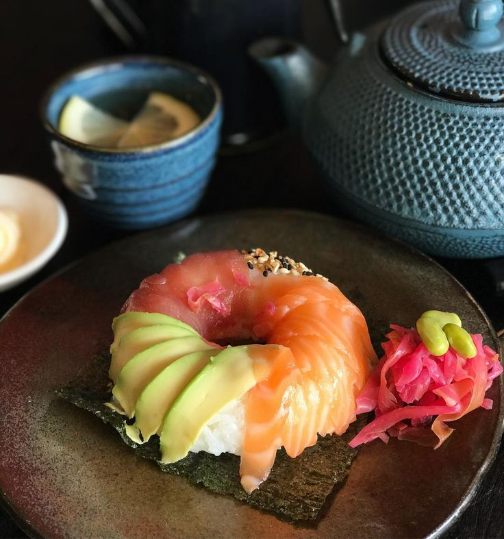 """Three Wise Monkeys is formerly known for their delicious Ramen, a traditional wheat noodle dish served in a meat or fish broth. While their signature dishes are looking amazing, their latest speciality is set out to get a lot of Insta-attention. The """"sushi donut"""" is probably the healthiest of its kind."""