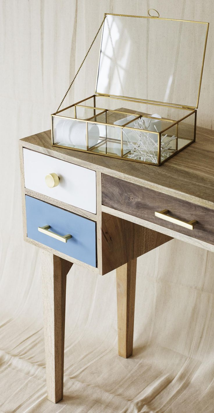 Mix your materials and showcase your trinkets in a novel way with this vintage inspired gold and glass jewellery box.