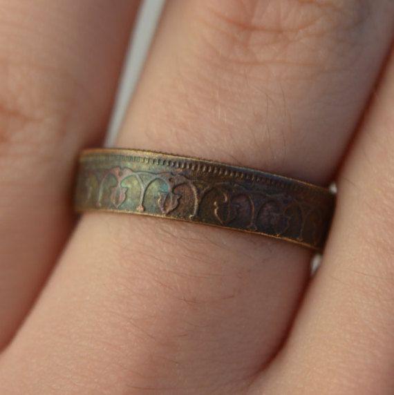 handmade ring made of a 20 Millimes (Tunisia) coin size(US): 8 1/2(inches): 2 3/8 (if you don`t know your ring size check the picture which is at the main site of my shop below my products)/ handgefertigter Ring aus einer 20 Millimes (Tunesien) Münze Größe(DE): 18.5 ;(mm): 58 (wenn Sie ihre Ringgröße nicht wissen schauen Sie sich das Bild auf der Startseite meines Shops an,das unter den Produkten ist) thanks for looking at my product/Danke für das Interesse an meinem ... $ 24
