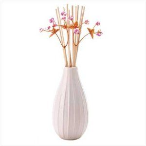Decorative Lavender Scent Diffuser by SWM. $5.99. Great Gift Idea.. Design is stylish and innovative. Satisfaction Ensured.. Manufactured to the Highest Quality Available.. graceful ceramic vase holds a bouquet of sweetly scented reeds for a doubly delightful decoration! Classic lavender aroma brightens any room with a long-lasting fragrance.  Includes wooden reeds; decorative berries; 2.4 fl. oz. fragrance oil. Vase is 2 3/4 inches diameter x 4 5/8 inches high; Overall: 10 ...