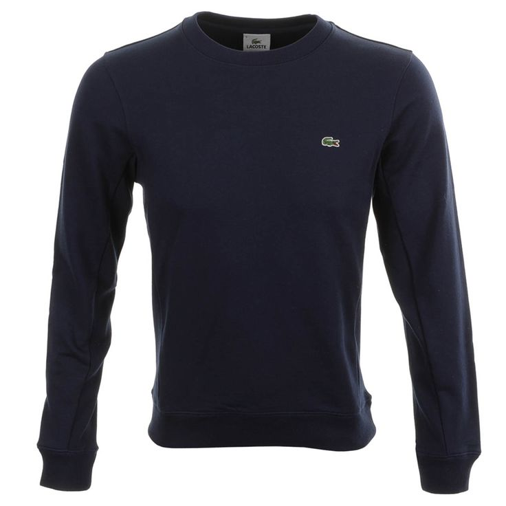 Lacoste Crew Neck Sweatshirt Jumper In Marine Navy, A ribbed crew neckline with ribbed cuffs on the long sleeves and a stretch ribbed waistband. Ribbed panels on the sides of the jumper and the underside of the sleeves. The signature embroidered Lacoste Crocodile logo is situated on the left of the chest in green, white and red. 100% Cotton. Quality And Style From Lacoste Jumpers And  Zip Tops Live Online UK.