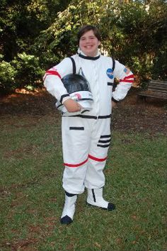 Astronaut costume using white painter's coverall and colored masking tape. Great idea for Blast Off VBS